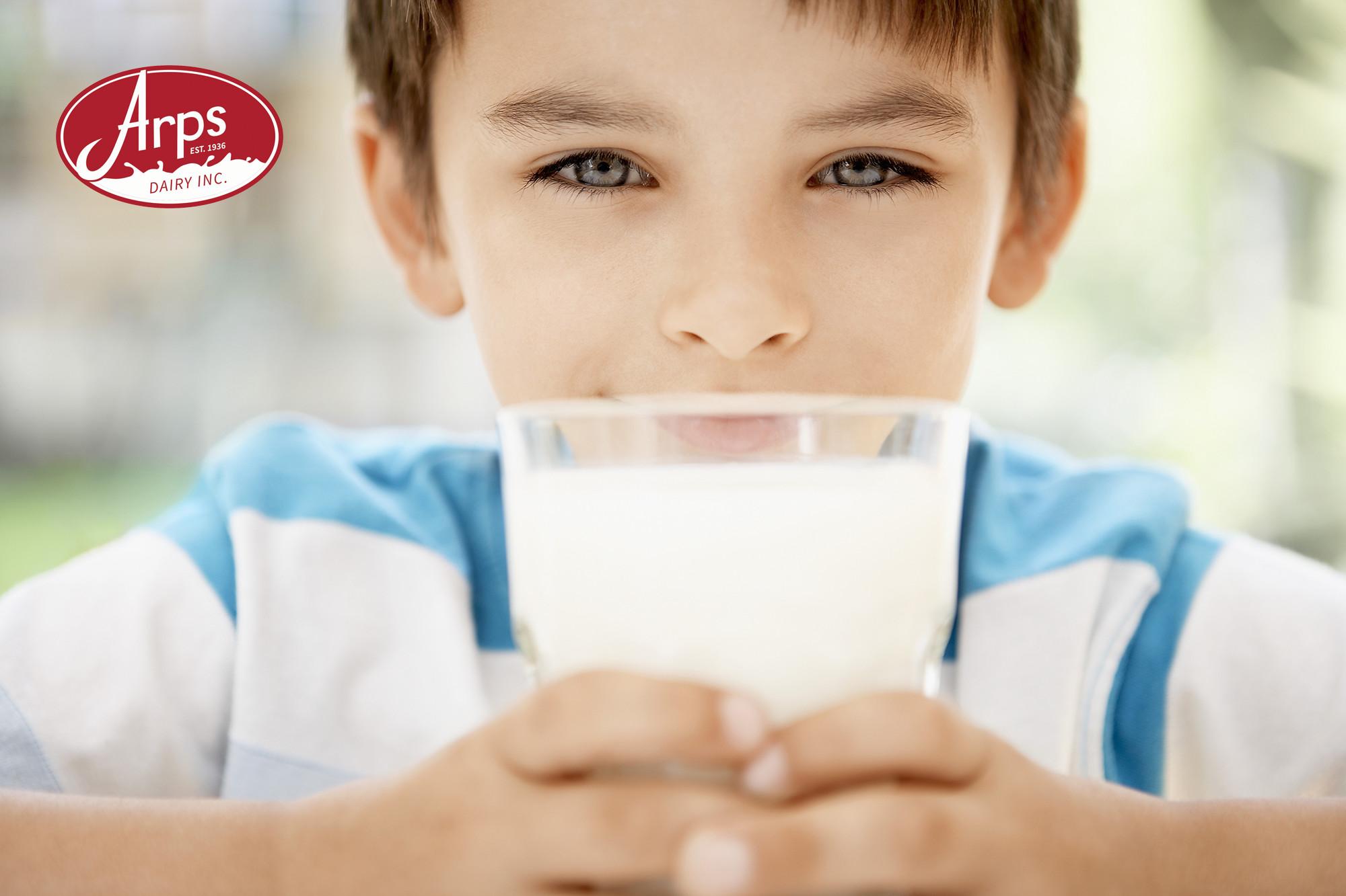 Arps Dairy - Boy Drinking Milk